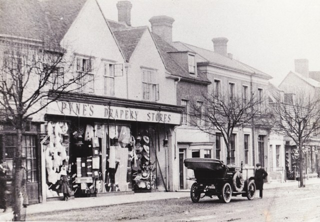 A lone motorist outside Pynes circa 1906